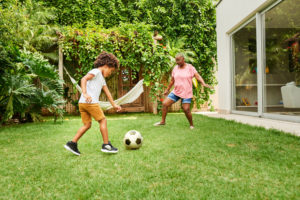woman playing soccer with son -- improve sports fitness -- weightlifting for women