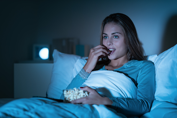 eating at night- woman eating in bed