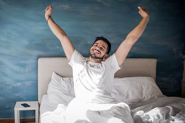 man waking up in bed | tips for running faster