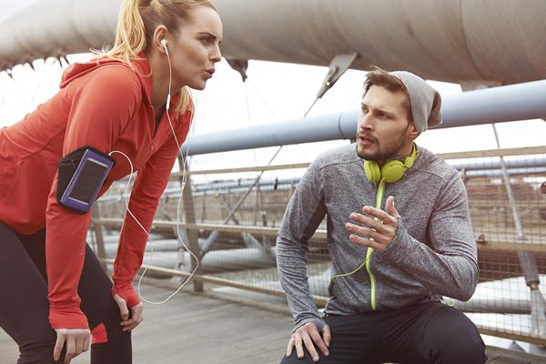 running coach helping runner | tips for running faster