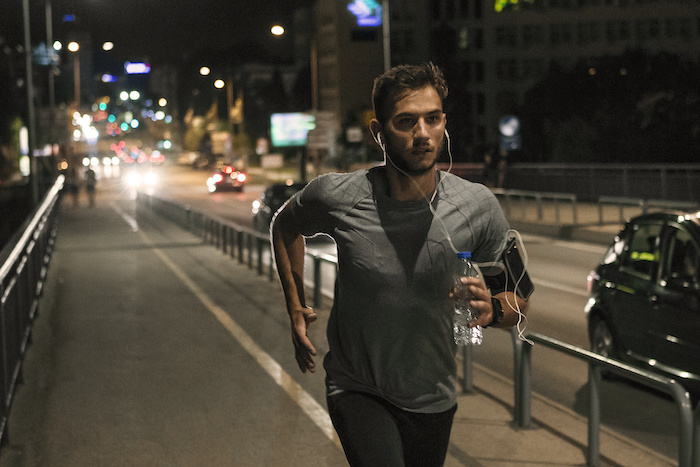 workout outside - man running at night