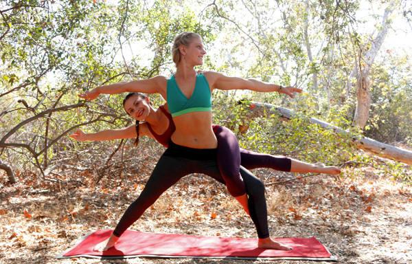 acro yoga pose - warrior intertwined