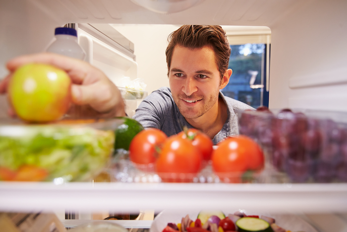 eating for weight loss- man looking in fridge