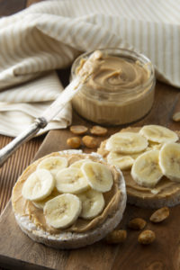 Rice cakes topped with peanut butter and sliced banana