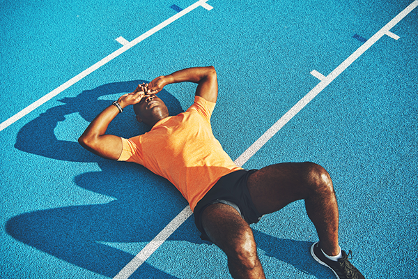 runner collapsed on track | motivate yourself to work out