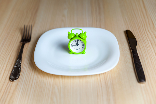fasted workout - plate with clock on it fasting