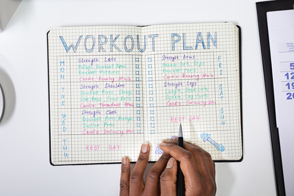 writing in workout journal | workout plateau