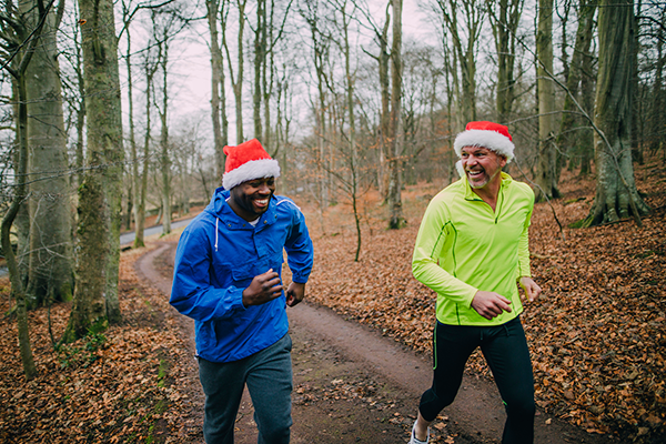 men with santa hats running | holiday weight gain