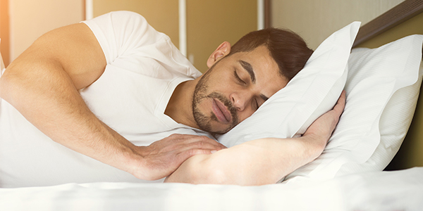 man sleeping | muscle building tips