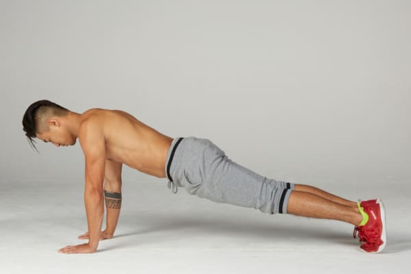 man performing a five minute plank