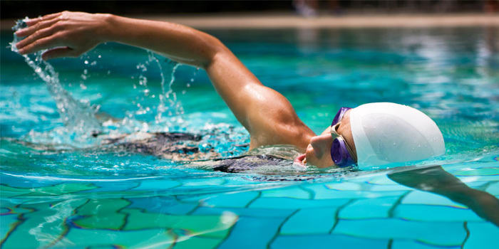 woman swimming Cardio Exercises - Swimming pool summer sports