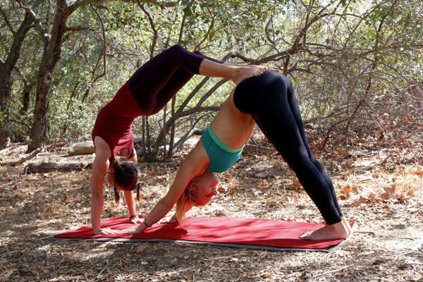 acro yoga pose - downward dog combo