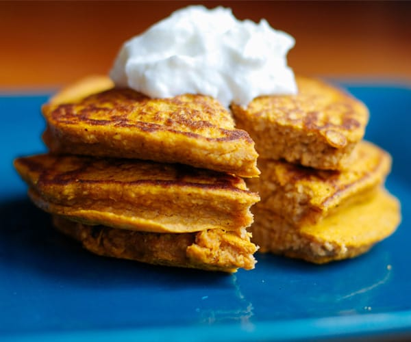 Pumpkin Protein Pancakes Topped with Greek Yogurt
