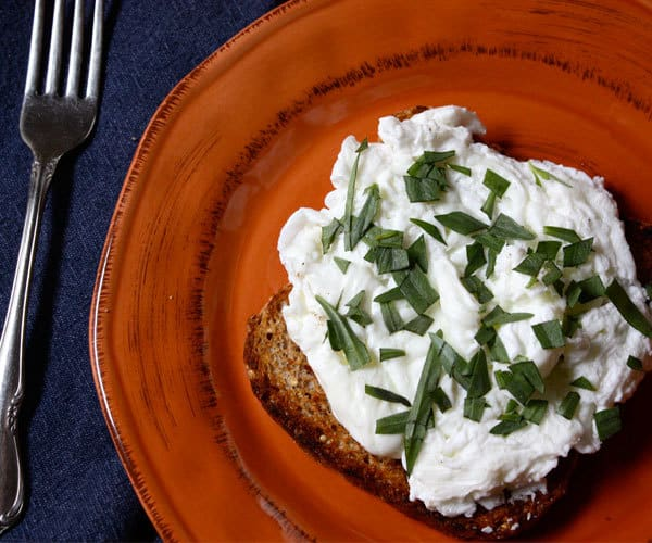 Herbed Poached egg whites on sprouted grain toast breakfast recipe.
