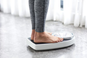 feet on scale--weight loss tips