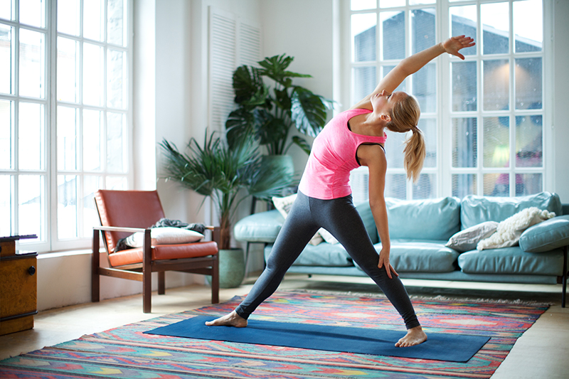 yoga misconceptions - woman doing yoga at home