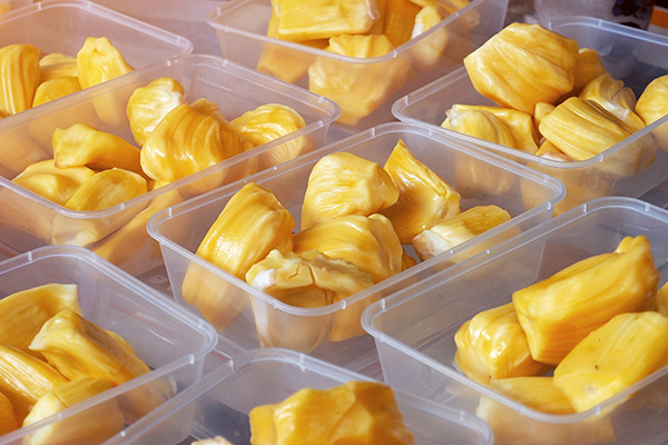 Sliced jackfruit in plastic trays