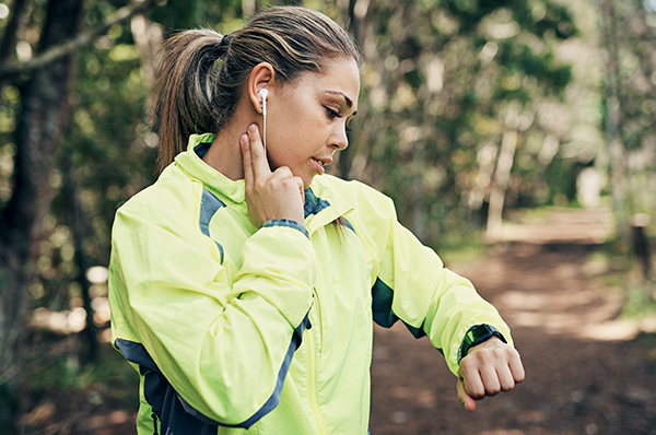 woman checking pulse - trail - watch - resting heart rate