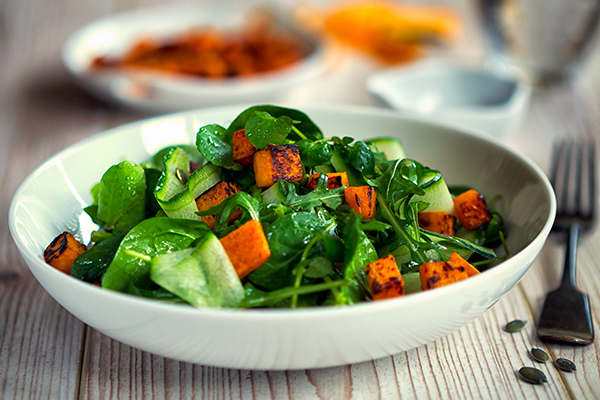 Healthy salad with greens and roasted sweet potatoes