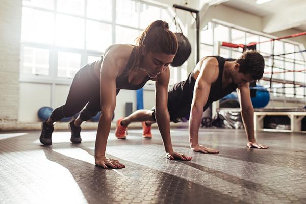 gym partners doing push ups | weightlifting program