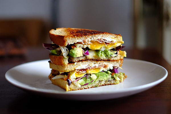 Sandwich with avocado and egg.