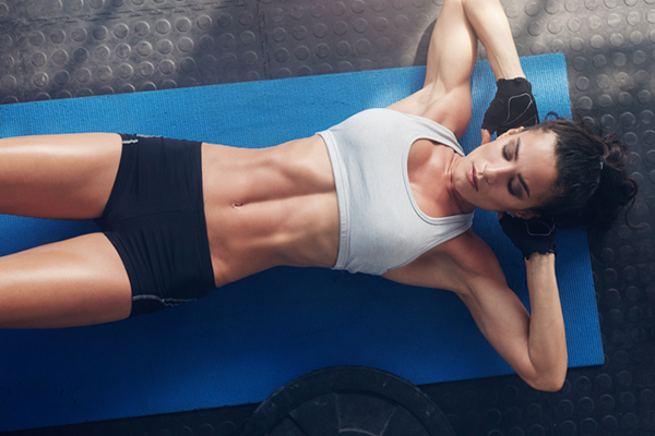 top down view of woman doing abs exercise   double crunch exercise