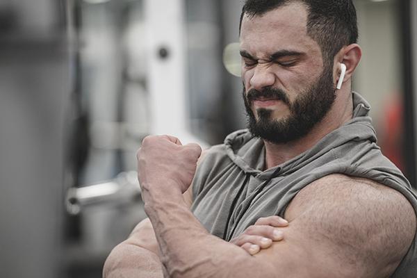 arm flex soreness gym
