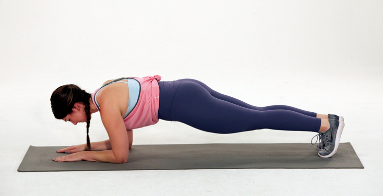 woman performing forearm plank