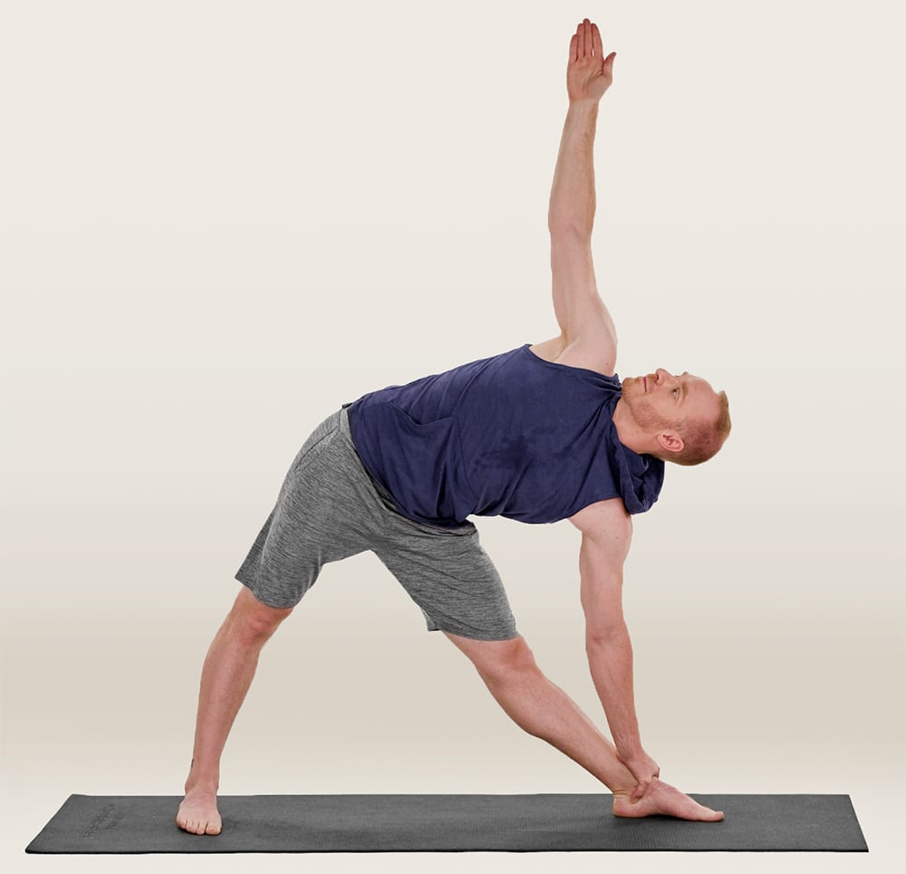 trikonasana triangle pose yoga man