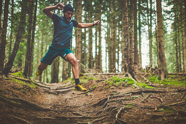 man running on nature trail | how to run a faster 5k