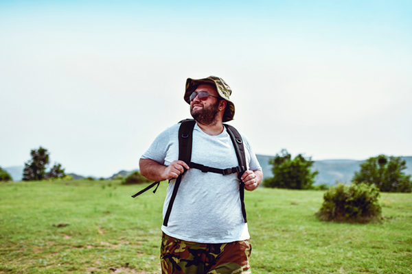 man taking morning hike   find time to work out