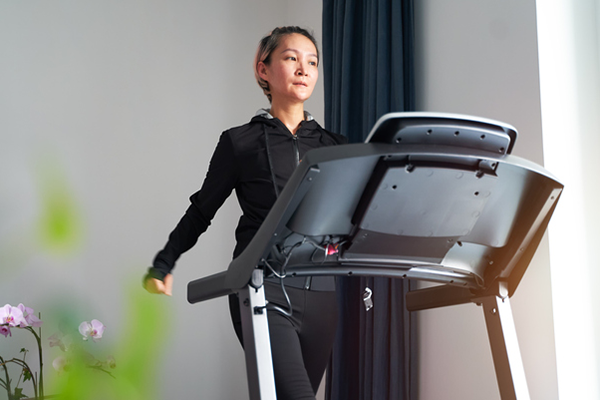 woman walking on treadmill   find time to work out