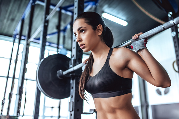 woman doing barbell squat   find time to work out
