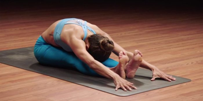 paschimottanasana seated forward fold woman