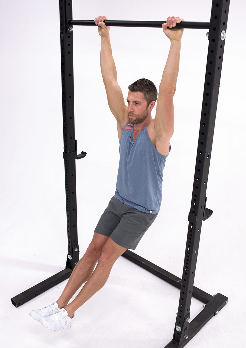 man performing hollow body hold isometric exercise