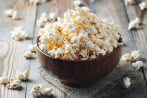 Popcorn in bowl, healthy snack salty craving