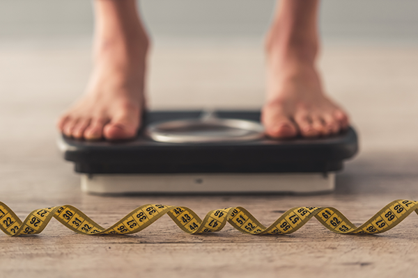 scale and tape measure | benefits of quitting drinking