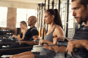 men and women using rowing machines--low impact cardio exercise