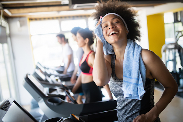 cardio for beginners- woman on treadmill will towel