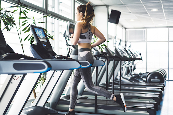 hiit treadmill training- woman alone on treadmill