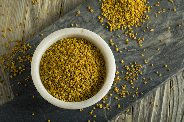 bee pollen benefits- bee pollen in a bowl