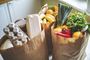 Grocery bags of healthy foods--fruit, vegetables, and proteins