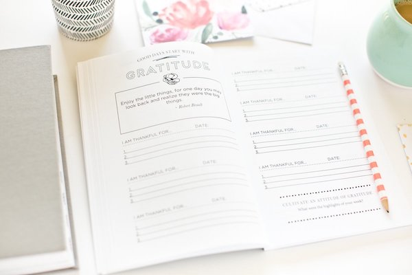 gratitude journal opened on a desk