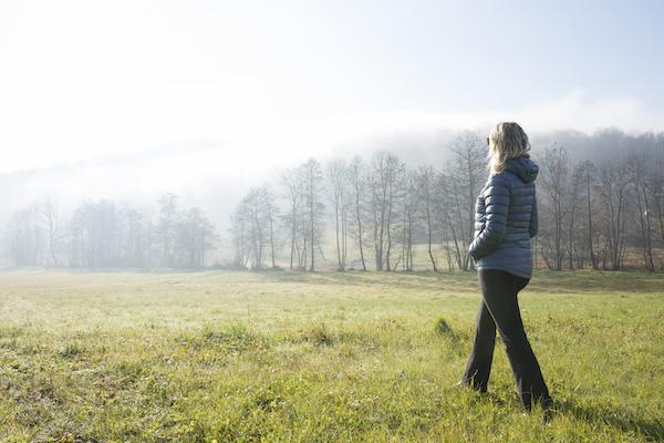 woman walking in an empty field