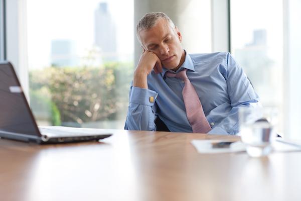 man napping at a desk