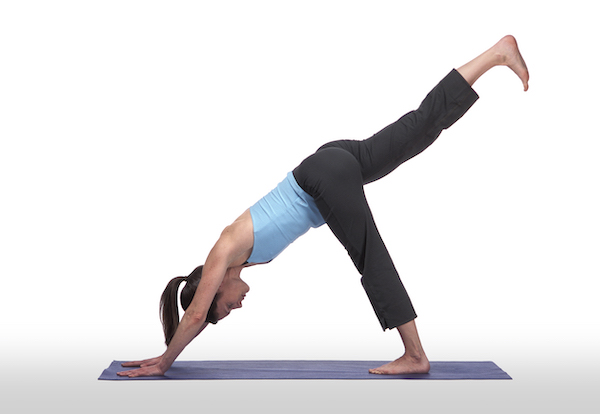 woman performing three legged downward dog