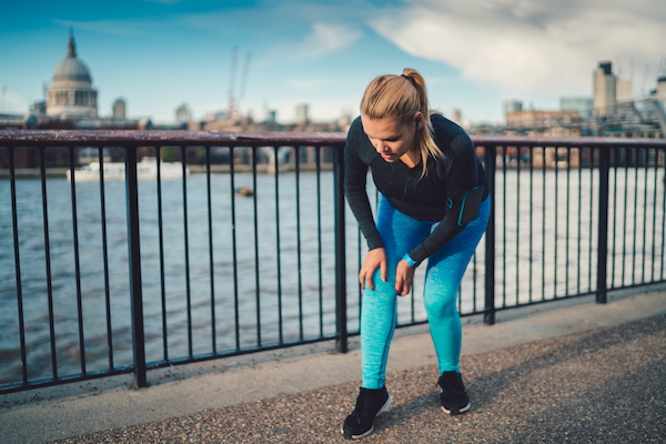 woman stopped from running due to leg cramps