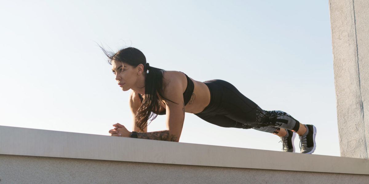 bodyweight myths - woman doing plank outside
