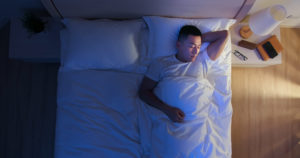 man getting a good night's sleep--lose weight quick