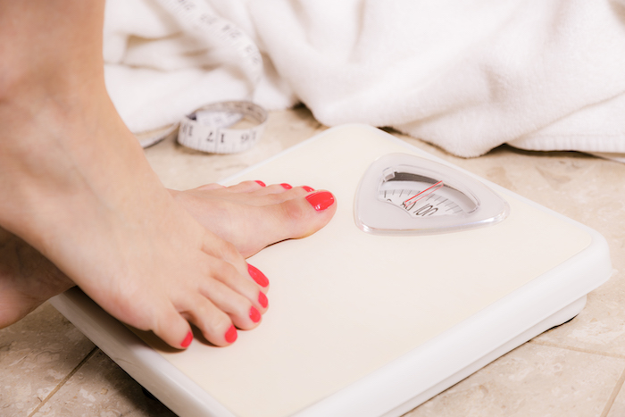 high fat diet- stepping on scale